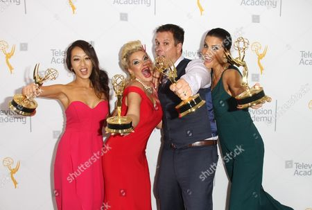 "EXCLUSIVE - Angel C. Kim, from left, Kimberly Cornell, Nick Simpson, and Lu Parker, winners of the Emmy for Medical News Story - Multi - Part Report ""3D Medical Technology: 3D Hand and Heart"" pose for a portrait at the L.A. Area Emmy Awards presented at the Television Academy's new Saban Media Center, in the NoHo Arts District in Los Angeles"