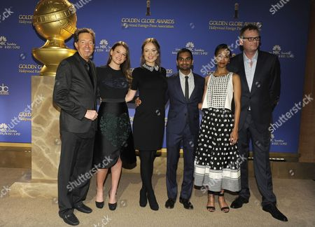 From left, Barry Adelman, Miss Golden Globe 2014 Sosie Bacon, Olivia Wilde, Aziz Ansari, Zoe Saldana and Hollywood Foreign Press Association President Theo Kingma pose on stage after the nominations for the 71st Annual Golden Globe Awards on in Beverly Hills, Calif. The 71st Annual Golden Globe Awards will be held on Sunday, Jan. 12, 2014