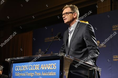 Hollywood Foreign Press Association President Theo Kingma on stage before the nominations for the 71st Annual Golden Globe Awards on in Beverly Hills, Calif. The 71st Annual Golden Globe Awards will be held on Sunday, Jan. 12, 2014