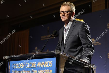 Hollywood Foreign Press Association President Theo Kingma is seen on stage before the nominations for the 71st Annual Golden Globe Awards on in Beverly Hills, Calif. The 71st Annual Golden Globe Awards will be held on Sunday, Jan. 12, 2014