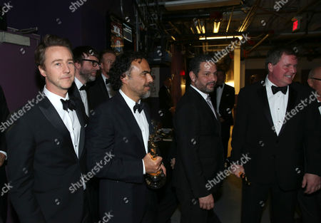 "Edward Norton, and from left, Alejandro Gonzalez Inarritu, Alexander Dinelaris and James W. Skotchdopole are seen backstage with their award for best picture for ""Birdman"" at the Oscars, at the Dolby Theatre in Los Angeles"