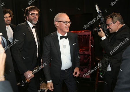 Armando Bo, and from left, Nicolas Giacobone and Michael Keaton are seen backstage at the Oscars, at the Dolby Theatre in Los Angeles