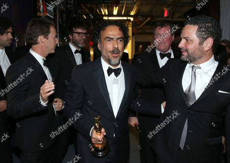 "Stock Picture of Edward Norton, and from left, Alejandro Gonzalez Inarritu, James W. Skotchdopole and Alexander Dinelaris are seen backstage with their award for best picture for ""Birdman"" at the Oscars, at the Dolby Theatre in Los Angeles"