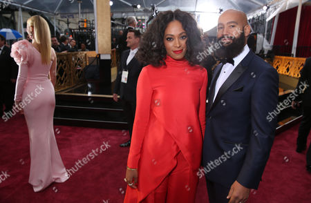 Solange Knowles, left, and Alan Ferguson arrive at the Oscars, at the Dolby Theatre in Los Angeles