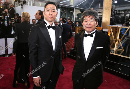 Yoshiaki Nishimura, left, and Isao Takahata arrive at the Oscars, at the Dolby Theatre in Los Angeles