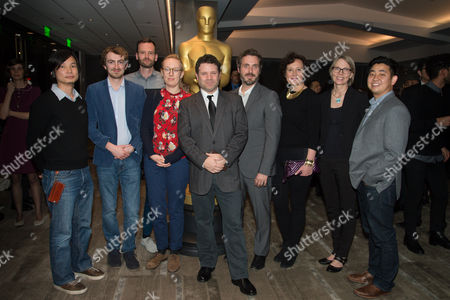 """Dice Tsutsumi, left, Christopher Hees, Joris Oprins, Daisy Jacobs, Sean Astin, Patrick Osborne, Kristina Reed, Torill Kove, and Robert Kondo arrive at the 87th Academy Awards - """"Shorts"""" at the Samuel Goldwyn Theater on in Beverly Hills, Calif"""