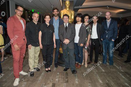 "James Lucas, left, Oded Binnun, Mihal Brezis, Julian Feret, Sean Astin, Hu Wei, Talkhon Hamzavi, Stefan Eichenberger and Michael Lennox arrive at the 87th Academy Awards - ""Shorts"" at the Samuel Goldwyn Theater on in Beverly Hills, Calif"