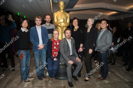 """Dice Tsutsumi, left, Christopher Hees, Joris Oprins, Daisy Jacobs, Patrick Osborne, Kristina Reed, Torill Kove, and Robert Kondo arrives at the 87th Academy Awards - """"Shorts"""" at the Samuel Goldwyn Theater on in Beverly Hills, Calif"""