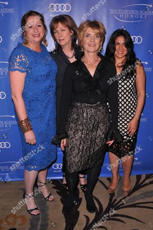 """Stock Image of MAY 2: (L-R) Executive producers Abigail Disney, Pamela Hogan, Gini Reticker and senior producer Nina Chaudry arrive at the Academy of Television Arts & Sciences Presents """"The 5th Annual Television Academy Honors"""" at the Beverly Hills Hotel on in Beverly Hills, California"""