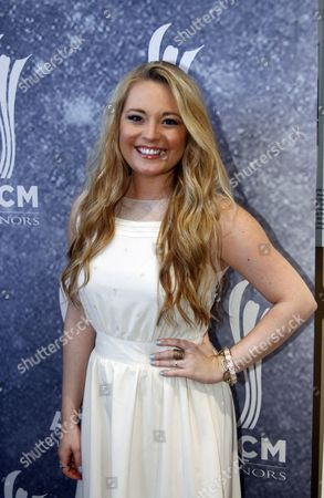 Stock Image of Janelle Arthur arrives at the ACM Honors at the Ryman Auditorium on in Nashville, Tenn