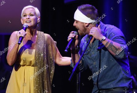 Lorrie Morgan, left, performs with her son Jesse Keith Whitley at the ACM Honors at the Ryman Auditorium on in Nashville, Tenn