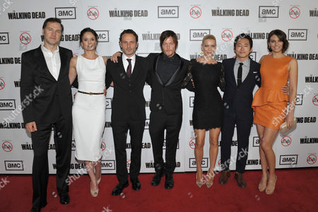 "From left, actors David Morrissey, Sarah Wayne Callies, Andrew Lincoln, Norman Reedus, Laurie Holden, Steven Yeun, and Lauren Cohan attend the season three premiere of AMC's ""The Walking Dead"" at Universal Studios, in Los Angeles"