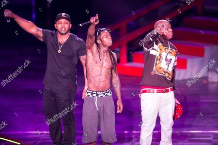 From left, Mack Maine (AKA Jermaine Preyan), Lil Wayne (AKA Dwayne Michael Carter, Jr.) and Birdman (AKA Bryan Williams) perform as a part of the America's Most Wanted Tour at the Verizon Wireless Amphitheater on in Irvine, Calif