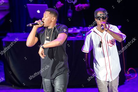 Stock Picture of From left, Hit Boy (AKA Chauncey Hollis) and Oktane (AKA Julian Brown) perform as a part of the America's Most Wanted Tour at the Verizon Wireless Amphitheater on in Irvine, Calif