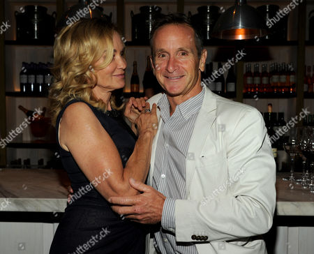 From left, actor Jessica Lange and EP Dante Di Loreto attend the American Horror Story: Coven Premiere Event,, at Fig & Olive in West Hollywood, Calif