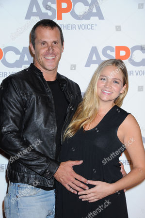 Stock Picture of Stephanie McIntosh, at right, and Pete Hieatt arrive at ASPCA Cocktail Event honoring Kaley Cuoco - Sweeting and Nikki Reed at a Bel Air private residence, in Los Angeles