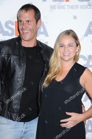 Stephanie McIntosh, at right, and Pete Hieatt arrive at ASPCA Cocktail Event honoring Kaley Cuoco - Sweeting and Nikki Reed at a Bel Air private residence, in Los Angeles