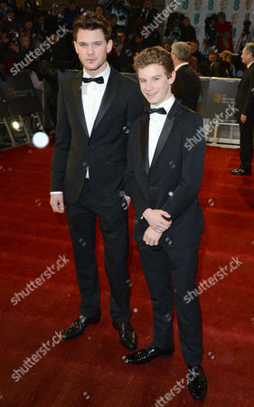 Stock Picture of Jeremy Irvine and Toby Irvine seen arriving for the BAFTA Film Awards at the Royal Opera House, in London