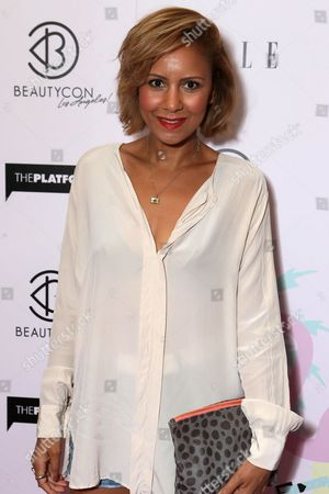 Taye Hansberry arrives at BeautyCon Los Angeles 2014 in Partnership with Elle at LA Mart, in Los Angeles