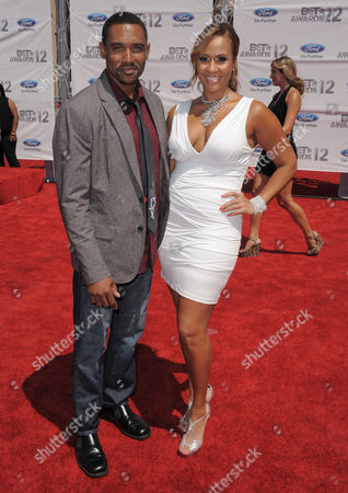 Kent Faulcon, left, and Kiki Haynes arrive at the BET Awards, in Los Angeles