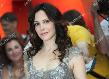 Stock Picture of Actress Mary-Louise Parker arrives on the red carpet for the European Premiere of Red 2 in central London. Parker, the award-winning star of Weeds, is writing a book about the ignificant men in her life. The book is called Dear Mr. You and is scheduled for next fall, Scribner announced Monday. Parker, 50, will tell her story through a series of letters. Her boyfriends have included actors Jeffrey Dean Morgan and Billy Crudup and singer Charlie Mars