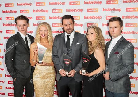 From left actors Sam Strike, Maddy Hill, Danny Dyer, Kellie Bright and Danny-Boy Hatchard pose for photographers with their awards for Best family, Best Actor and Best Soap at the Inside Soap awards, held in central London