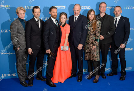 Charley Palmer, Mel Raido, Tom Hardy, Emily Browning, Brian Helgeland, Tara Fitzgerald, David Thewlis and Christopher Eccleston, pose for photographers at the World Premiere for Legend at a central London cinema, London