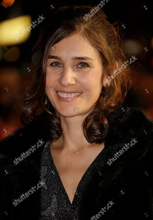Juliette Towhidi poses for photographers at the premiere for the film Testament of Youth, in London