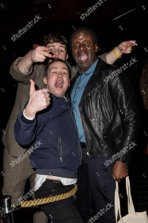 Gary Powell, right, of the Libertines poses with fans upon arrival at the NME Awards 2016 Afterparty in London
