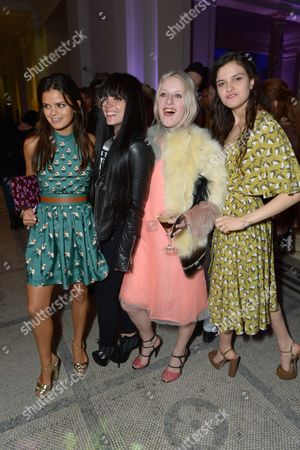 From left, Bip Ling, Lily Allen, Harriet Verney and Evangeline Ling attend the Glamour of Italian Fashion VIP Night at the Victoria and Albert Museum in London