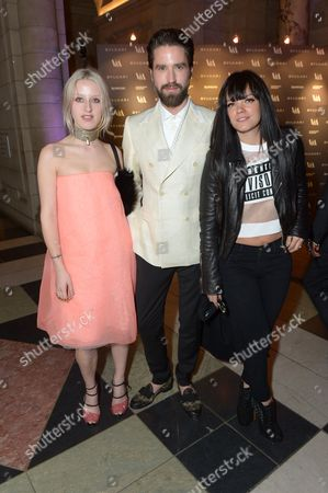 From left, Harriet Verney, Jack Guiness and Lily Allen attend the Glamour of Italian Fashion VIP Night at the Victoria and Albert Museum in London