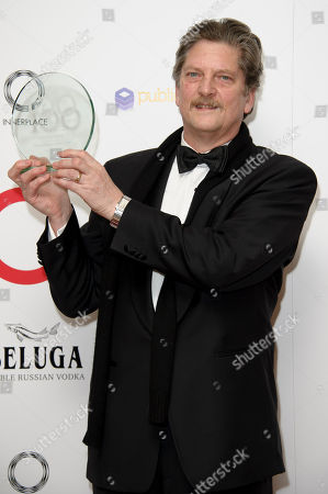 Andre Singer with his award for Documentary of the Year at The London Critics Circle Awards, in London