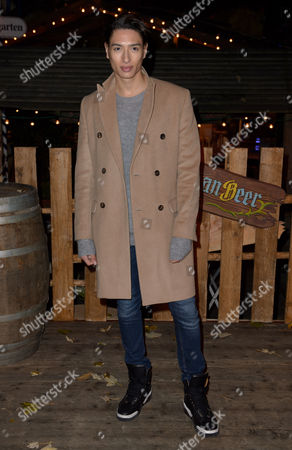 Nat Weller poses for photographers at the opening of the Winder Wonderland attraction in Hyde Park, London