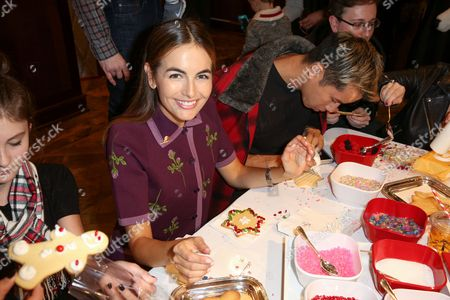 Camilla Belle, left, and Jared Eng decorate cookies at the Brooks Brothers 2nd Annual Los Angeles Holiday Party, in Beverly Hills, Calif