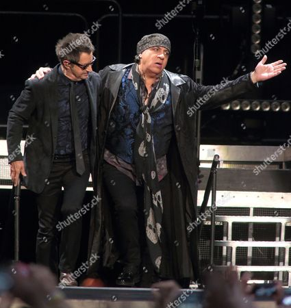 Stock Image of Garry Tallent, left, and Steven Van Zandt perform in concert with Bruce Springsteen and the E Street Band during their The River Tour 2016 at the Royal Farms Arena, in Baltimore