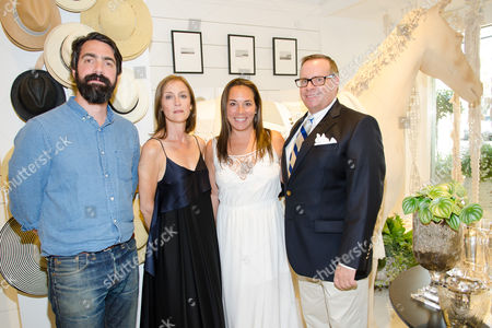 Aaron Levine, Caroline Belhumeur, Samantha Yanks, and Larry Horton attend a Club Monaco store opening event in Southampton on in New York