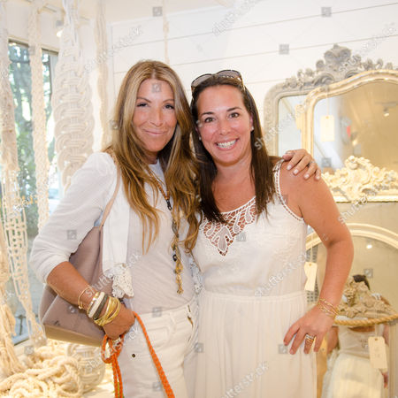 Jennifer Miller and Samantha Yanks attend a Club Monaco store opening event in Southampton on in New York