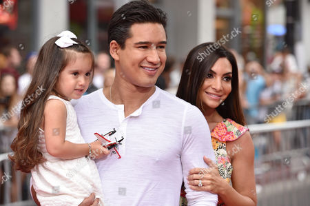 Mario Lopez, center, and from left, Gia Francesca Lopez and Courtney Laine Mazza arrive at the premiere of Disney Planes: Fire & Rescue sponsored by Coco Joy Kids at El Capitan, in Los Angeles