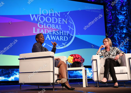 Ursula Burns, chairman and CEO, Xerox Corporation, recipient of the 2015 John Wooden Global Leadership Award, and Maggie Wilderotter, executive chairman, Frontier Communications, speak at the Eighth Annual John Wooden Global Leadership Award Dinner at the Beverly Wilshire hotel, in Beverly Hills, Calif