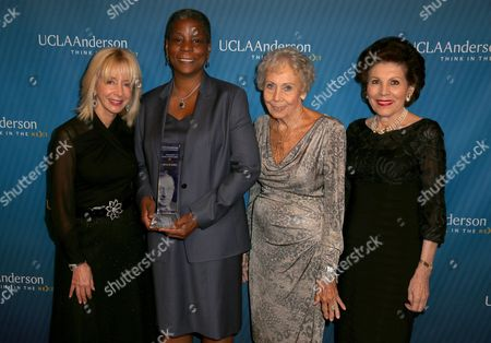 Judy Olian, dean, UCLA Anderson School of Management, from left, recipient of the 2015 John Wooden Global Leadership Award, Ursula Burns, chairman and CEO, Xerox Corporation, Nan Wooden Muehlhausen and Marion Anderson attend the Eighth Annual John Wooden Global Leadership Award Dinner at the Beverly Wilshire hotel, in Beverly Hills, Calif
