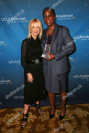 Stock Image of Judy Olian, dean, UCLA Anderson School of Management, and Ursula Burns, chairman and CEO, Xerox Corporation and recipient of the 2015 John Wooden Global Leadership Award, attend the Eighth Annual John Wooden Global Leadership Award Dinner at the Beverly Wilshire hotel, in Beverly Hills, Calif