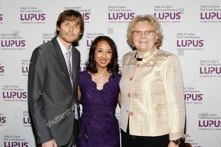"""Honorees and Co-creators and executive producers of Marvel's Agents of S.H.I.E.L.D. Maurissa Tancharoen Whedon, and Jed Whedon, and Chief Medical Officer of UCB, Dr. Iris Loews-Friedrich seen at the Lupus Foundation of America's """"Evening of Hope"""" Gala, on in New York"""