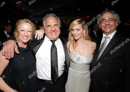Claudia Lewis, President of Production, Fox Searchlight, and from left, Jim Gianopulos, President and CEO, 20th Century Fox, Reese Witherspoon and Steve Gilula, President, Fox Searchlight, are seen at FOX's 72nd annual Golden Globe Awards Party at the Beverly Hilton Hotel, in Beverly Hills, Calif