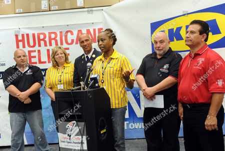 Evamay Lawson, at podium, IKEA Sustainability Manager, joins John Hodge, second right, and Tony Navarino, right, of the Stephen Siller Tunnel to Towers Foundation to announce that IKEA will be donating home furnishings, valued over $200,000, to help Hurricane Sandy victims, in Staten Island, NY. Also pictured, from left to right, are Joseph Cardinale, of Stephen Siller Foundation, Tracey Kelly, of IKEA, and Jack Oehm, of the FDNY. For more information visit http://www.ikea.com/us/en/about_ikea/newsitem/2013_IKEA_Hurricane_Sandy_Donation_Tunnels_to_Towers