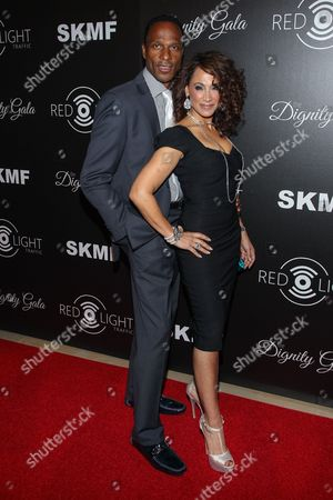 Former NFL player Willie Gault (L) and wife actress Suzan Brittan arrive at the Inaugural Dignity Gala at the Beverly Hilton Hotel on in Beverly Hills, Calif