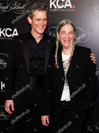 Peter Twyman, left, and Patti Smith, right, attend Keep a Child Alive's 13th Annual Black Ball at the Hammerstein Ballroom, in New York