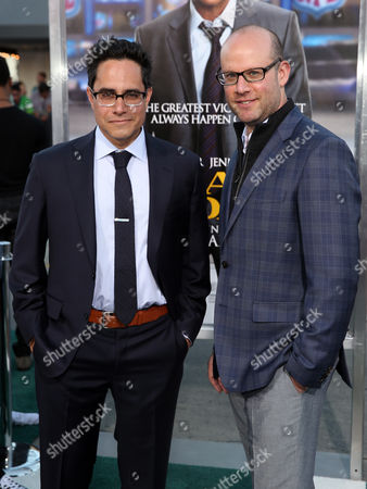 "Scott Rothman, right, and Rajiv Joseph arrive at the premiere of ""Draft Day"" on in Los Angeles"