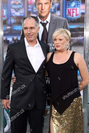 "Patrick St. Esprit, left, arrives at the premiere of ""Draft Day"" on in Los Angeles"
