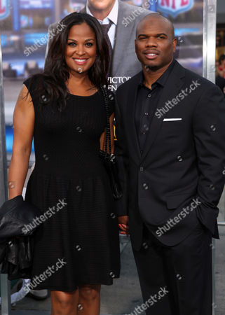 """Laila Ali, left, and Curtis Conway arrive at the premiere of """"Draft Day"""" on in Los Angeles"""