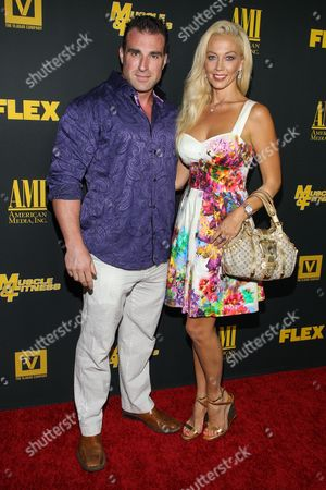 "From left, Body builder Kagan Yalaman and actress Liz Fuller arrive at the premiere of ""Generation Iron"" at the Chinese 6 Theatres on in Los Angeles"
